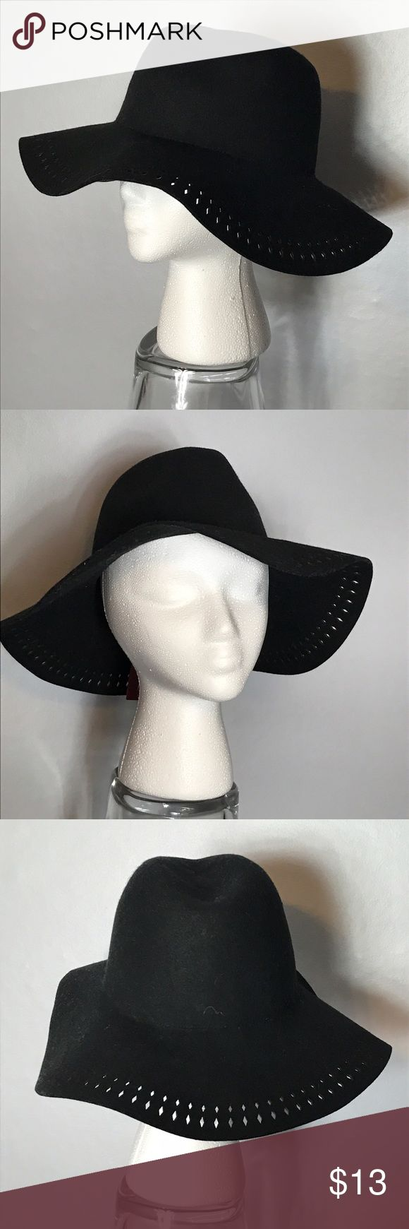 Floppy black wool hat Absolutely stunning. Brand-new with tags. Laser cut outs give it an accented look around the brim Accessories Hats