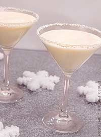 Two Turtle Doves Ingredients:- 1 1/2 oz Smirnoff vodka- 1 oz coconut cream- 1 oz half and half- 1/4 oz creme de cacaoMix all ingredients in a cocktail shaker with ice. Strain into a chilled martini glass rimmed with shaved white chocolate rim