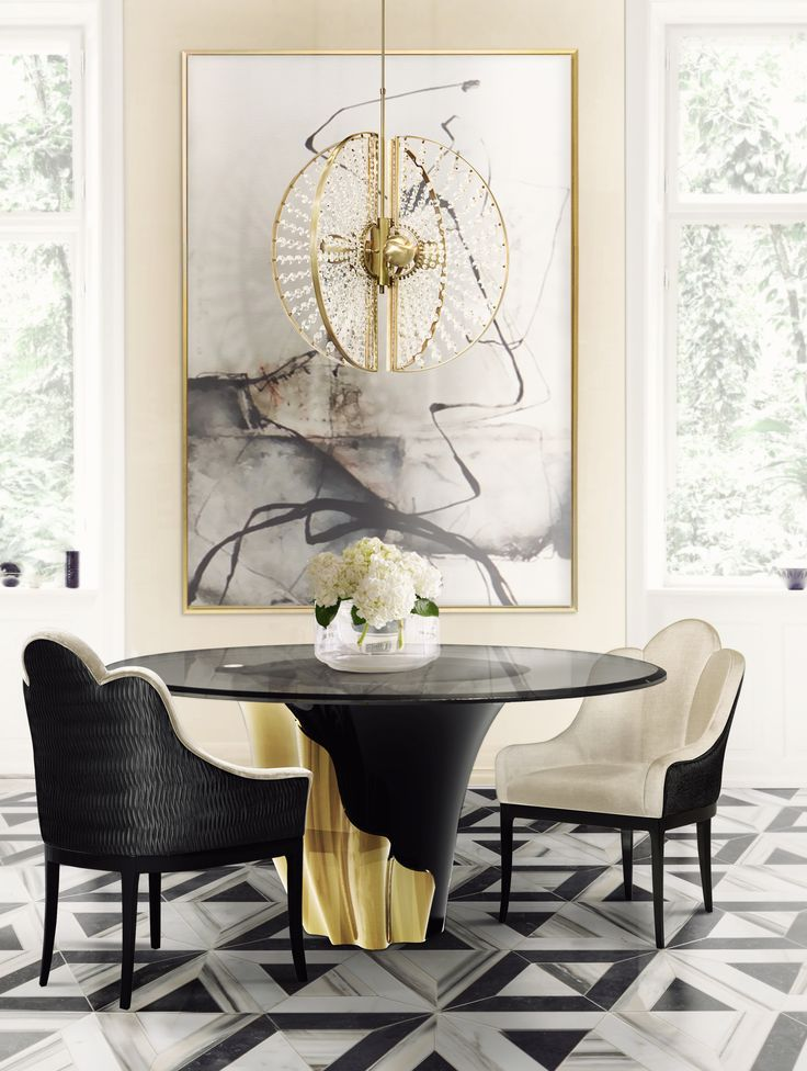 A central piece to any space, the contemporary design of the Yasmine table will have everyone doing double takes. The sultry silhouette is fashioned from tailored smoked glass and mounted on a solid wooden base. Classic black lacquer and luxurious gold plated intermix arching back and forth to reveal each color's respective dominance in the design.