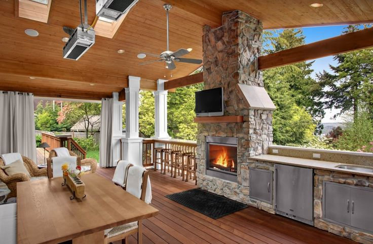 Craftsman Porch with Sunstone grills flush double access doors, Transom window, Outdoor kitchen, Skylight, Wrap around porch