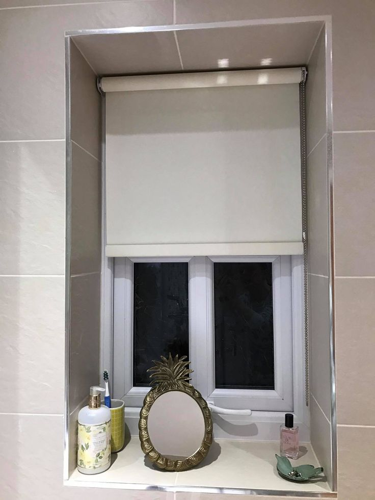 bathroom blinds installed these are moisture resilient roller blinds