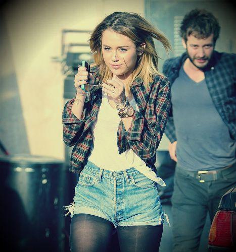 df65fb3a572124 Miley  Cyrus  plaid shirt  white  tee  jean  shorts  black  tights ...