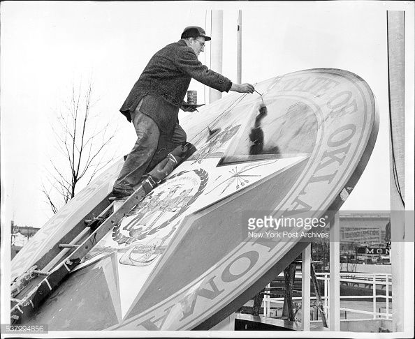 News Photo : Getting ready for tomorrow's World's Fair opening...