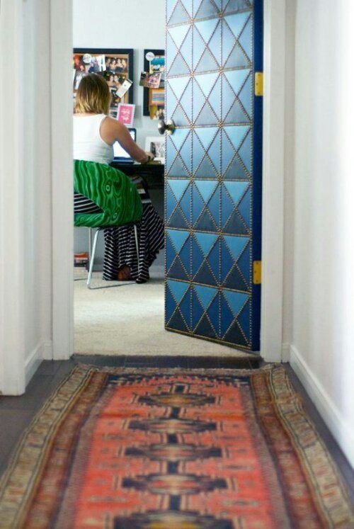 Door made of leather scraps and nailheads. Gorgeous!