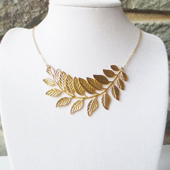 This modern necklace with a touch of nature features a large gold plated leaf pendant that has been curved to achieve a unique look. A beautiful