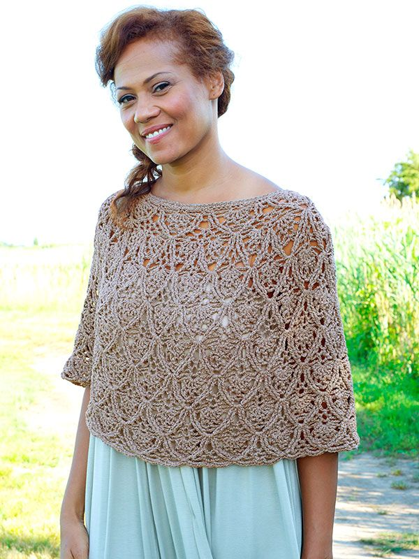 Lisbon is a beautiful lace poncho crocheted in the round from the top down.  This free pattern is available exclusively as a print-friendly PDF file - it's easy to read and requires less paper when printed. To download the pattern, just click the PDF link above. Trouble getting the PDF? Make sure you've downloaded the latest version of the freeAdobe Reader software.