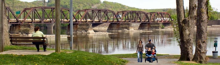 People relax, enjoy the view of a bridge and walk at the Marina at Shikellamy State Park, Pennsylvania.  hiking, biking, scenic views, picnic, pavilions, marina, boating, boat launching, boat rental, fishing, world's largest inflatable dam, bicycle & jet ski rentals, store