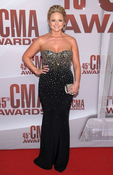 Miranda Lambert is stunning in a black strapless dress as she arrives on the red carpet at the 45th annual CMA Awards in Nashville on Nov. 9, 2011