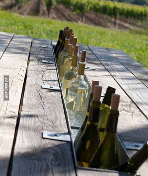 Some genius swapped the middle board of this table with a gutter to make a table top bar!