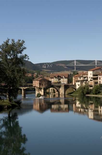 Millau, juxtaposition of ancient village with the ultra modern bridge in the background