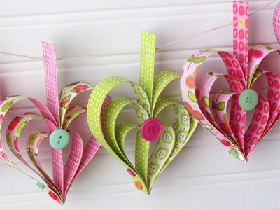 Paper heart garland made from patterned paper with Glue Dots and buttons! Super easy to make with the kids!