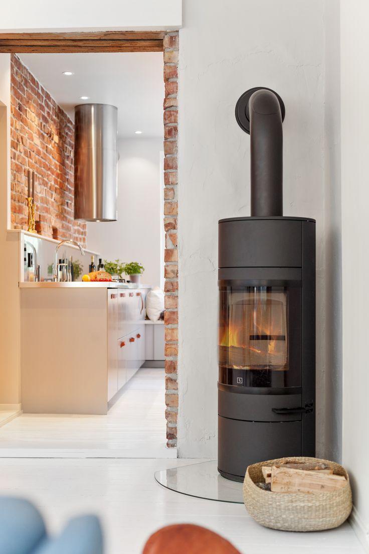 Round fireplace, brickwall, kitchen. Architect/designer, Lisa Wettsjö+Gustav Wettsjö