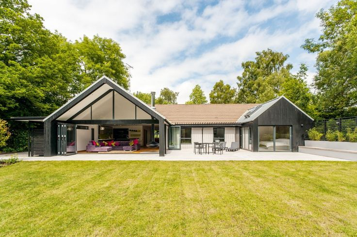 With advice from an architect Ian and Lynne Hiscock transformed their dated bungalow with a glass extension and contemporary interior to create their dream home