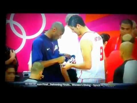 Kobe Bryant Signs the Shoe of a Player on Team Tunisia After the Game