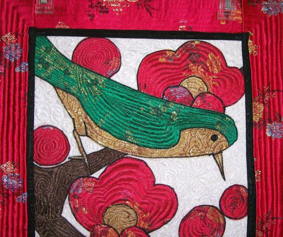"Art Quilt. Bird on a Limb. Korean Art ""Uguisu"": ""which sits on the branch of a plum tree""2. $350.00, via Etsy."