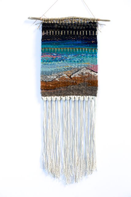 "Inspiration! This one-of-a-kind wall hanging was handwoven on a lap loom using wool, yarn (including reclaimed), and Pendleton blanket scraps. Tied to found driftwood and ready to hang. Made in Portland, Oregon. 2014.8.5"" x 25"""