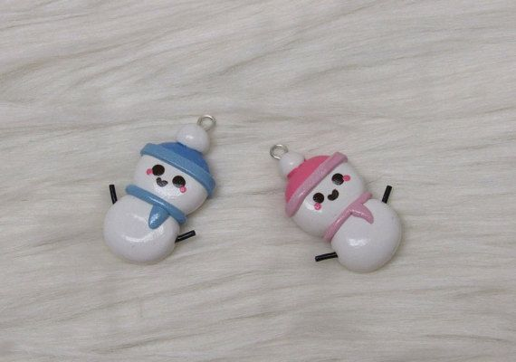 This is a Snowman polymer clay charm with a pink or blue hat and scarf. Each charm measures approximately 0.5W x .75H. Due to the handmade nature of these charms, each item might slightly vary in sizes. The charms are made with varnished polymer clay with zipper/cellphone cord.  Please remember that polymer clay items are delicate in nature so a gentle use is recommended.
