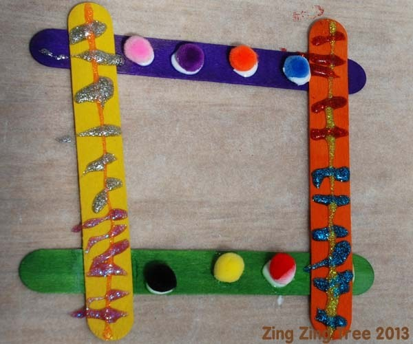 Lolly stick / Craft stick frames are brilliant. They're relatively cheap (depending on what you decorate them with), easy to do, versatile, great for children of all ages and most importantly they look good hung on the wall.
