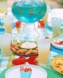 I'm thinking about a sprinkler party for Jack's birthday....with fishy decorations and menu.  Love?