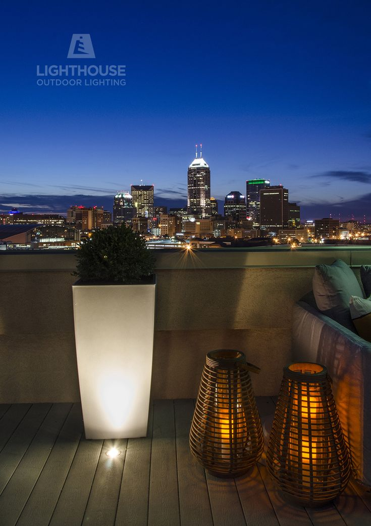 Small accent lights bounce light off the planters and back onto this indianapolis rooftop deck