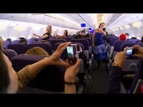 Overheard on YouTube: I would rather watch a hula flash mob than any movies they show on the plane. That's awesome. :) // Details: A hula dance group traveling from San Francisco, California to Honolulu, Hawaii (both in the U.S.) surprised their fellow passengers on a Hawaiian Airlines flight with a hula dance performance. // Date and flight location: Hawaiian Airlines, July 14, 2011, Flight 11, San Francisco to Honolulu, Hawaii. // Found by @RandomMagicTour…
