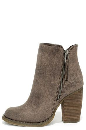 "Despite its name, you can't beat the Sbicca Percussion Taupe High Heel Booties! These adorable ankle boots are true winners with a tumbled faux leather upper, almond toe, and gunmetal zipper decorating the outstep. A notched 5.5"" shaft includes a working zipper at the instep."