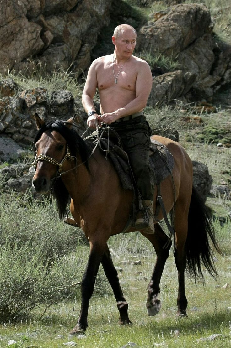 Barechested horseback riding