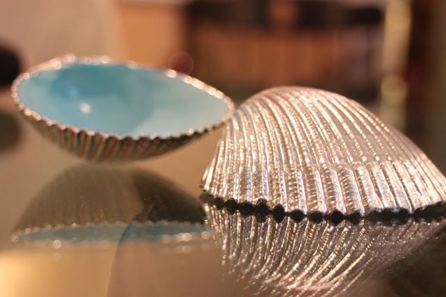 These shells, by Chic Done Cheap, are spray painted. Kick it up a notch and give it a more high-end look with silver or gold leaf.