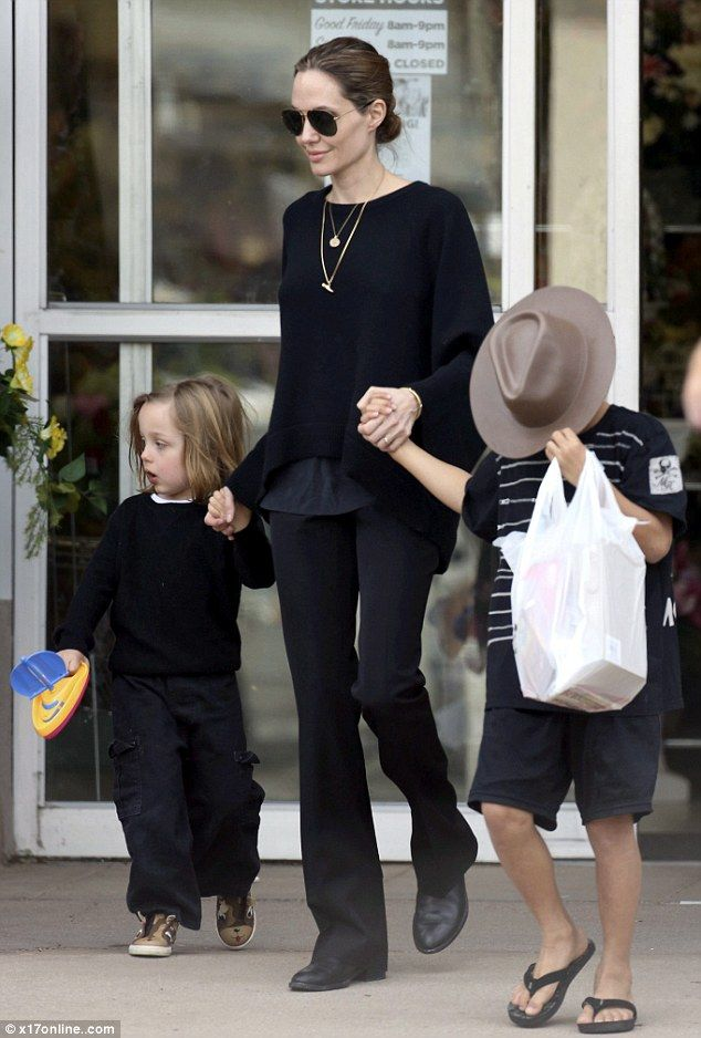 Angelina Jolie with Knox and Maddox after returning from Rwanda.