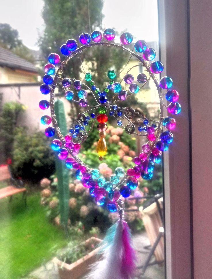 Handmade crystal and glass butterfly sun catcher.