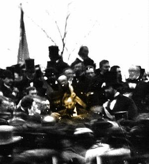 November 19, 1863: President Lincoln speaks at Gettysburg. Weak, dizzy, and haggard, the President spoke for only 2 minutes, in a speech now regarded as one of the finest in the English language. Lincoln was ill for some time afterwards, and may have been suffering from a mild case of smallpox. This is the only known photograph of Lincoln on that day. He is the figure highlighted in sepia.