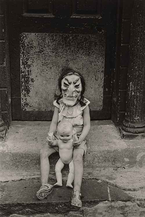 Masked Child with a Doll, 1961 photo by Diane Arbus