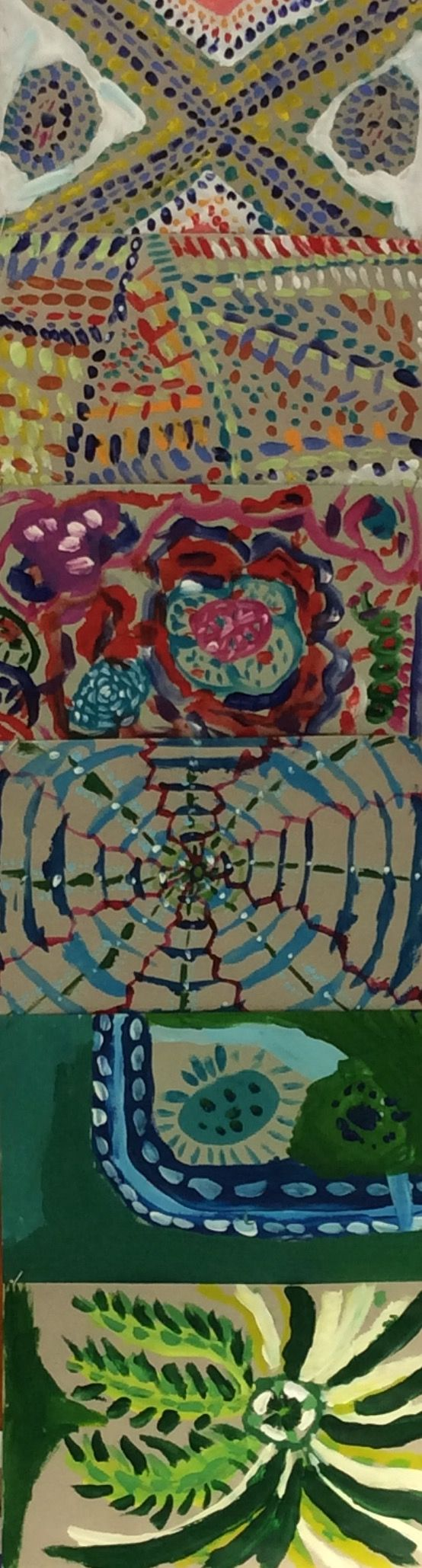 Another close up of the Year 5 and 6 students paintings celebrating NAIDOC Week.