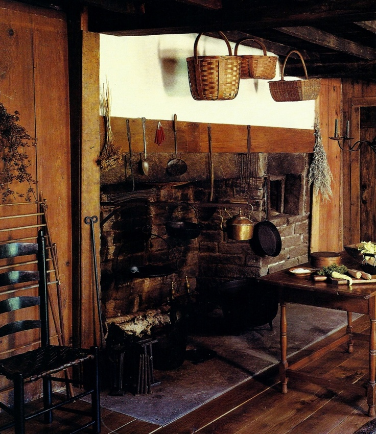 Fireplace, antique baskets, early black ladderback chair, early table, iron cook ware