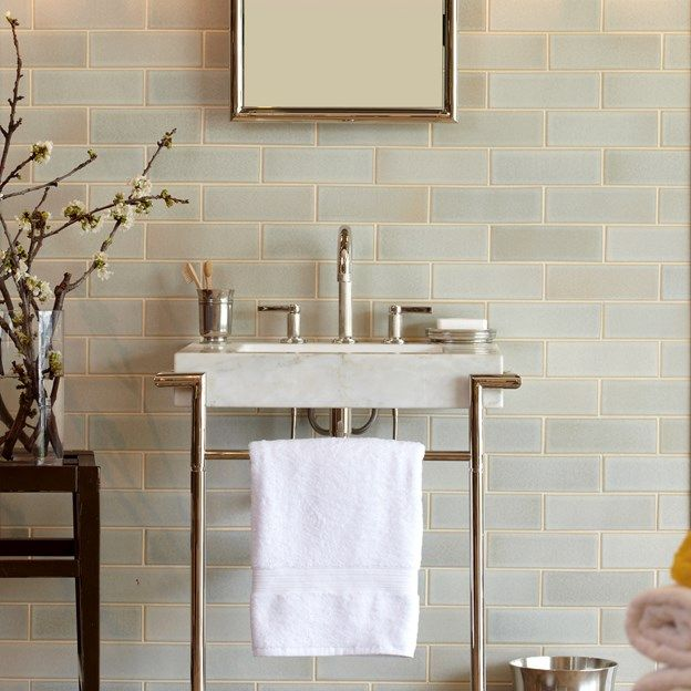 Bathroom wall idea: subway tile with a twist. Mix both classic and modern styles by going with a neutral blue or grey instead of classic white. The glazing on this ceramic tile backsplash gives it a grey-blue hue with just a hint of gold where the glaze breaks. Gorgeous!. Click for product details.   (photographer: Phillip Ennis, designer: Jason Trotter)