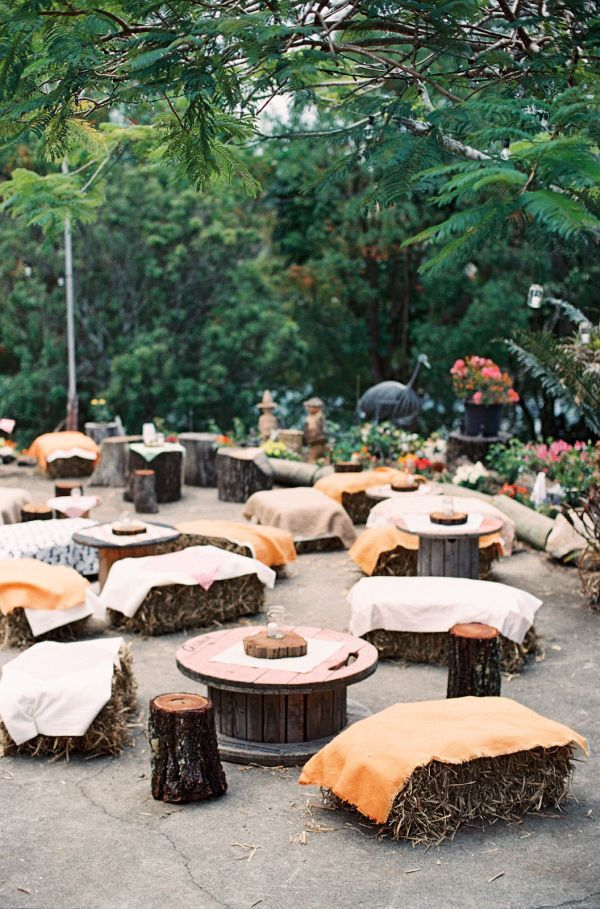 Wood + hay bale tangerine wedding lounge