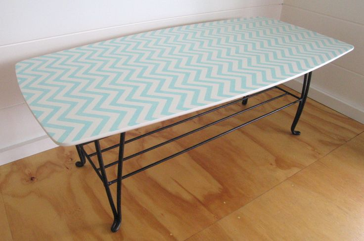 Upcycled Retro Coffee Table In White, With Hand Painted Blue Chevron Embellishments and Original Rustic Metal Base
