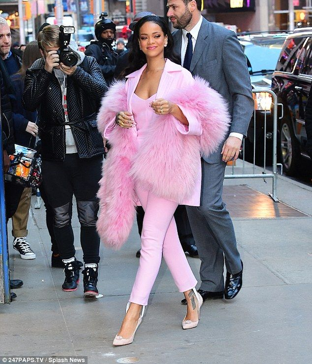 Fluffy: Adding to her Barbie pink jumpsuit and blazer combo, Rihanna looked cosy in an ove...