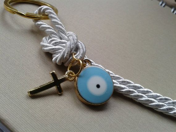 Evil eye martyrika for the Orthodox baptism day-key ring favor  Beautiful martyrika with evil eye and cross in golden shade .They can also be used as favors  Key rings diameter is 0.98 Evil eyes diameter is 0.6 All your guests will leave with a keepsake from your baptism so as to remember it for long.  This listing is for ten(10) pc  Thank you for visiting