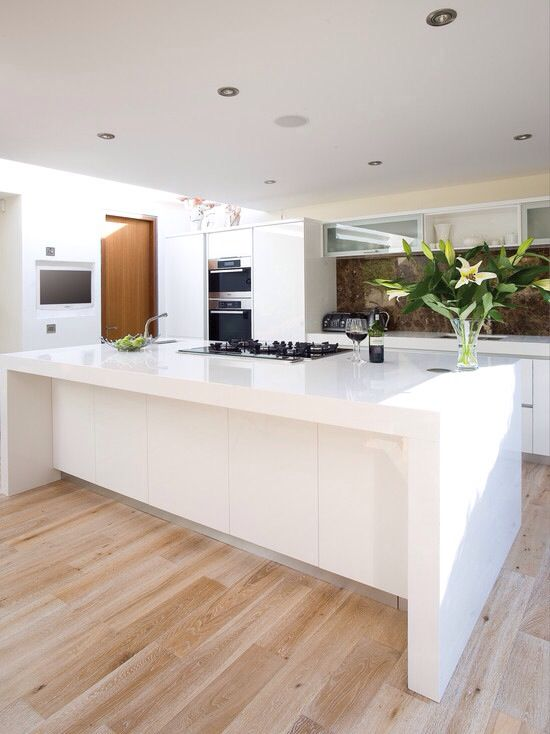 White kitchen. Wooden floor