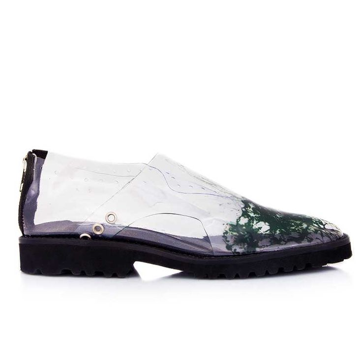 Casual flat shoes. Made from transparent silicone imprinted with abstract…
