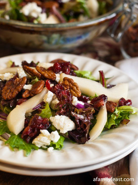 A delicious salad recipe made with mixed baby greens, pears, goat cheese, dried cranberries and amazing spiced pecans!