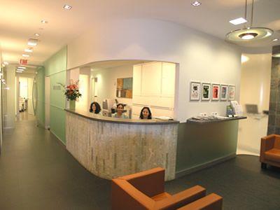 Reception Desk: Gray Floors, Light Ceilings, Light Green.
