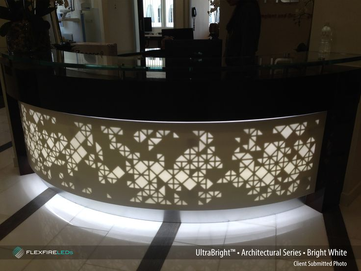BlueGate Surface Works illuminates the custom-cut corian surface of the welcome desk with LED strip lights. Amazing!