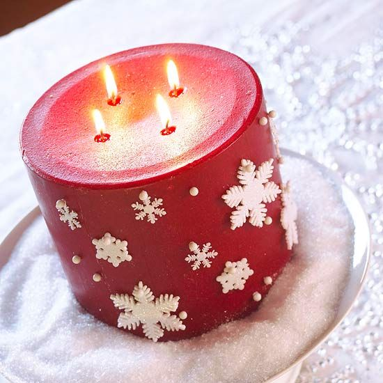 Snowflake Candle Decor  Secure mini snowflake ornaments to a large red candle using white map push pins -- or any short pin with a round white head. Use additional pins as polka dots. Nestle the candle in a plate or decorative bowl filled with Epsom salts to simulate snow.