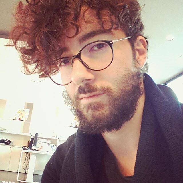 A Photograph Of A Curly Male With A Shaggy Taper Haircut For His Dyed Red Hair Which Is Complemented With Curly Hair Men Curly Hair Styles Beautiful Curly Hair