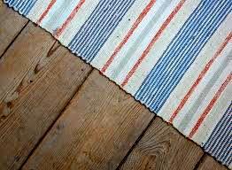 "No Swedish log cabin without rag rugs! (""trasmatta""). Sweden."