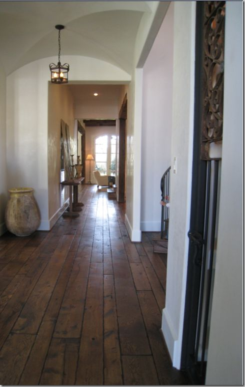The floors are gorgeous deep brown 100 year old reclaimed for 100 floors floor 79