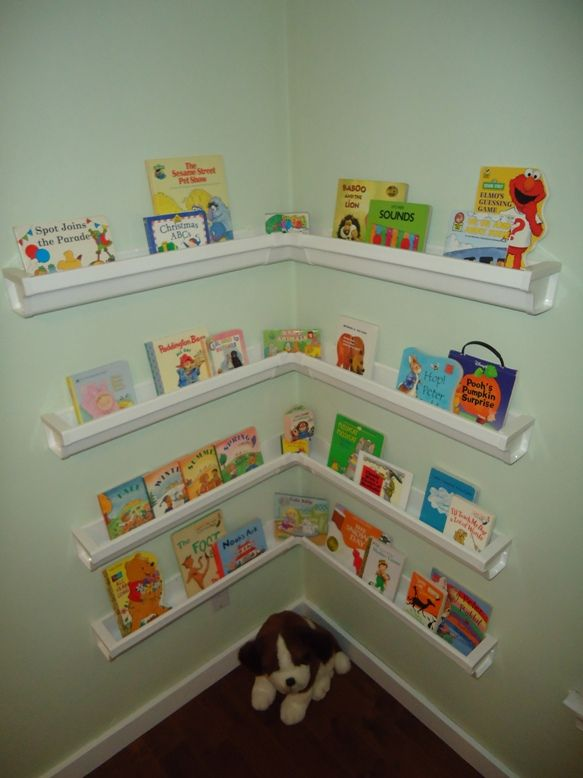 Rain gutter bookshelves for the nursery