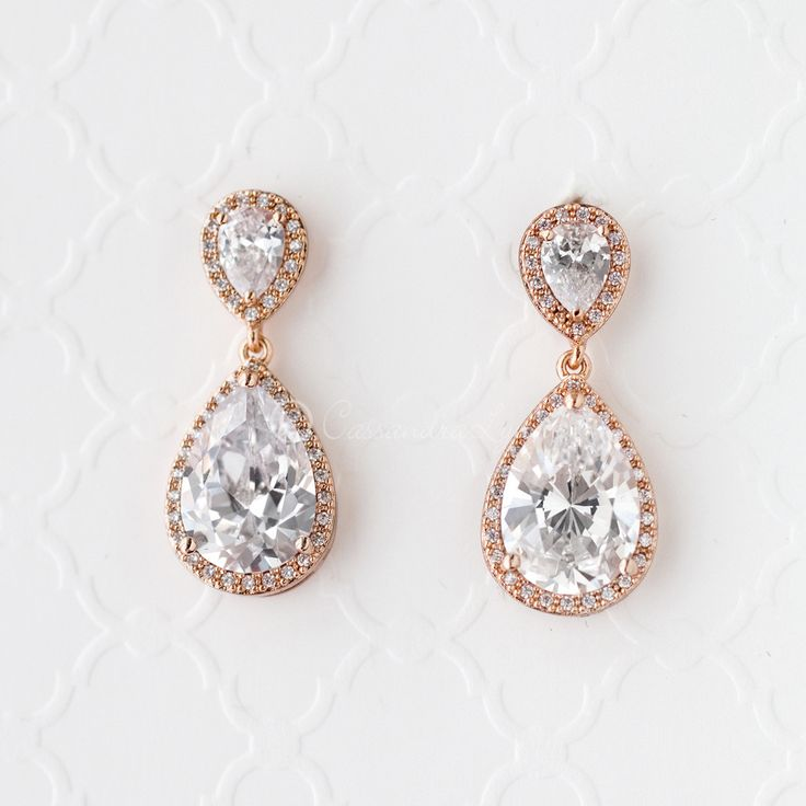 Rose gold wedding earrings of pear cut cubic zirconia.